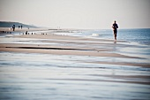 Joggers at beach of Westerland, Germany