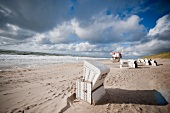 Hooded beach chairs on Westerland beach and Rotes Kliff in Sylt, Germany