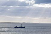 View of fishing boat on North Sea, Sylt, Germany