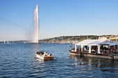 View of Jet d'eau fountain with boat in Jardin Anglais, Lake Geneva, Switzerland
