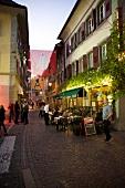 People on street near cafe Restaurant du Leman, Geneva, Switzerland