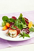 Goat's cheese saltimbocca on a bed of salad