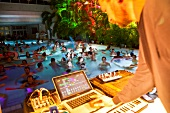 People in pool at Antigel festival with DJ Robert Lippok, Collonge-Bellerive, Switzerland