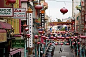 Busy street of Chinatown overlooking the Bay Bridge in San Francisco