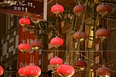 Chinese lanterns near facade of Chinatown in San Francisco, California, USA