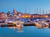 View of Alghero harbour with boats in Mediterranean sea in Sardinia, Italy