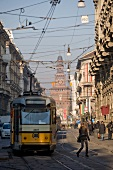People at tram with power cable in Via Dante, Milan, Sardinia, Italy