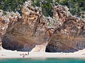 View of two caves from Mediterranean Sea, Cala Luna, Gulf of Orosei, Sardinia, Italy