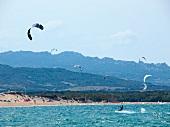 People kite surfing at Porto Puddu, Sardinia, Italy