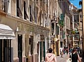 People on street in Alghero, Sardinia, Italy