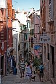 People walking in alley in old town Rovinj, Croatia