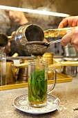 Mint tea in poured in glass, local Casablanca, Cologne calk district