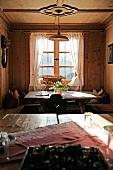 View of dining area in living room of Oberhaslerhof, Italy