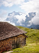 View of mountains and hut on landscape in Alps, Switzerland