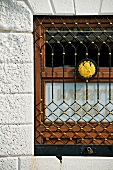 Close-up of lattice window of Harry's bar, Venice, Italy