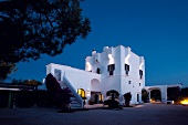 Exterior of Masseria Torre Coccaro hotel at night, Contrada Coccaro, Italy