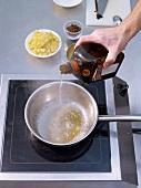 Step, Rohrzucker karamellisieren, mit Orangenlikör ablöschen