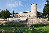 Couple sitting in garden in front of Hannover History Museum. Hanover, Germany