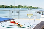 Plate of foods and drink on table in terrace of restaurant in Maschsee, Hanover, Germany