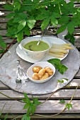 Steamed asparagus with basil sauce and potatoes