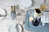 Crockery, cutlery and glasses on a wooden table