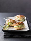 Mini chicken burgers with cucumber and wasabi
