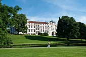 View of Celle Castle with trees and lawn, Lower Saxony, Germany