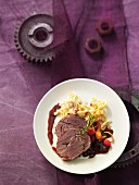 Sauerbraten (marinated roast venison) with a cherry and rosemary sauce