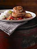 Grilled turkey medallions with a plum and lime sauce
