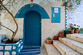 Entrance with blue door in alley at Safed, Israel