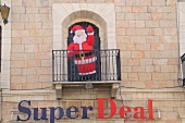 Toy santaclaus in balcony above super deal, Bethlehem, West Bank, Israel