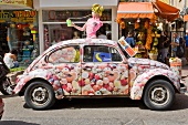 Car with doll at fruit juice stand at Sheinkin street, Tel Aviv, Isreal