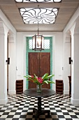 Interior with checker board tiles and table with vase, Galle Fort, Sri Lanka