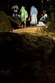 Pilgrims climbing steps at night on Sri Pada mountain, Sri Lanka