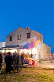 People at Sant'Efisio Church at blue hour, Nora, Cagliari, Sardinia, Italy, blurred motion