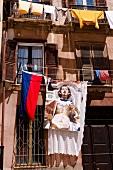 Flag on facade, Sardinia, Italy