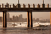 View of sea beach, pier and surfers at Durban, South Africa