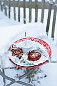 Beetroot with wasabi sour cream on a piece of aluminium foil in the snow