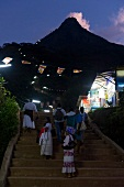 Pilgrims climbing stairs at night in Sri Pada mountain, Sri Lanka