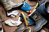 Overhead view of dirty rubber boots and jackets for Mudflat hiking