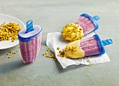Homemade blueberry and pistachio ice lollies