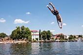 Man diving in Muggelsee lake in Berlin, Germany