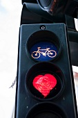 Close-up of traffic lights with heart and cycle symbol in Berlin, Germany