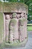 Memorial block of woman with moss by Ingeborg Hunzinger in Berlin, Germany