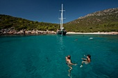 View of sailing boat and people in sea, Bodrum, Turkey