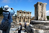 Vacationers clicking photos of library of ancient Ephesus, Aegean, Turkey
