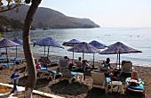 Tourists relaxing on beach of Hayitbuku, Mesudiye, Datca, Turkey