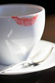 Lipstick marks on a coffee cup (close-up)
