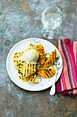 Grilled pineapple, passion fruit and mango with vanilla ice cream