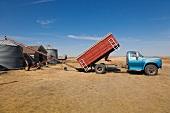 View of truck discharging wheat in ranch on highway 6 South, Saskatchewan, Canada